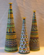 "<p>Stunning 13.5"", 11.5"" and 9.5"" hand painted vases by master potter, Patrizio Chiucchiu, Deruta, Italy, featuring  modern cone shapes with traditional geometric patterns first used in the sixteenth century. In excellent condition.</p>"
