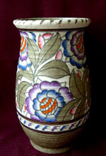 <p>Lush 9&quot; vase in the Persian Rose pattern by artist and designer Charlotte Rhead for Crown Ducal, circa 1930s.  In excellent condition.</p>
