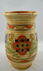 "<p>Charlotte Rhead 8.75"" vase in the rare Mexican decor, circa 1940. Small firing line to the base, in the making and a miniscule glaze miss.  In otherwise excellent condition. This particular piece was decorated by Fanny Morey one of Charlotte's most trusted tube liners.</p>"