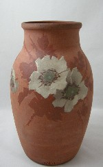 <p>Stunnning 12.25&quot; Tirrube vase with handpainted white roses and vines on a red bisque body, circa 1905-1908.&nbsp; In excellent condition.</p>