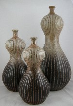 <p>Stunning three double gourd vase group by Donna Craven.&nbsp; Donna comes from a long line of North Carolina potters.&nbsp; She is a very talented artist that is just coming into her own with major exhibitions in North Carolina museums.&nbsp; The vases measure 22&quot;, 16&quot; and 14&quot; and are in excellent condition.</p>