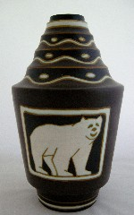 <p>One of the most sought after decors ever produced by Boch Freres Keramis, the matte enamel polar bear vase.&nbsp; Standing 13&quot; tall, our vase D1063, F1095 is a very rare shape, features bears in three poses and has been authenticated by Marc Pairon.&nbsp; The vase is in excellent condition, circa 1930s. Additional photos of the vase are available apon request.</p>