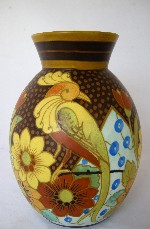 <p>Charming lyre bird and floral vase by Boch Freres Keramis, D1849, F1271, 1934. Initialed by Jan Wind, our vase is in excellent condition.</p>