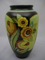 <p>Monumental Boch Freres Keramis 13.5&quot; floral matte enamel vase, D2504, F914, 1939. Signed by Victorrio Bonzutti. In excellent condition.</p>