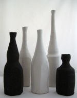<p>Group of five bottles in black and white by Akiko Hirai. Sizes in descending order are 12&quot;, 9.5&quot;, 8.75&quot;, 8&quot; and 5.25&quot;. In excellent condition.</p>